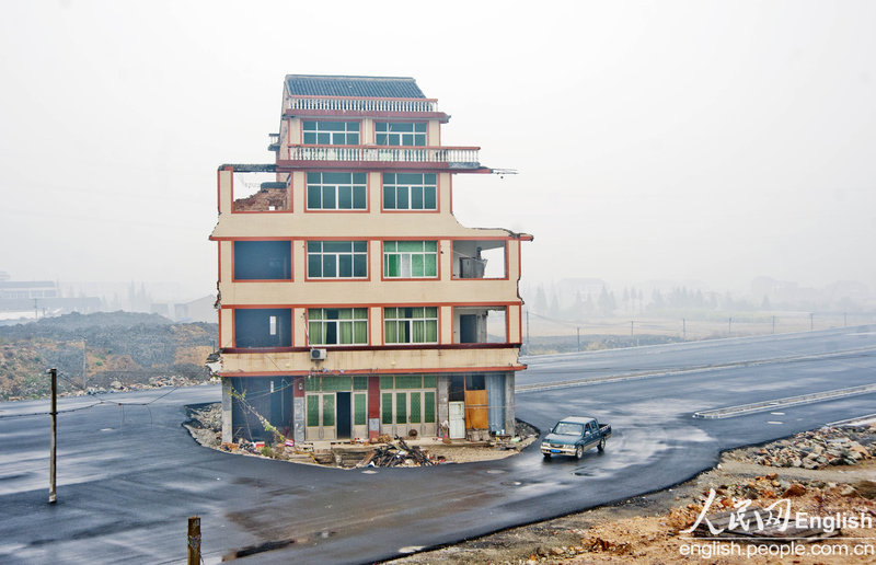 Chinese road built around house